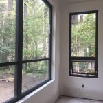 Drywall return windows. Black custom window frames in dinning room