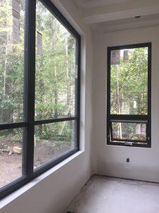 Drywall return windows. Black custom window frames in dinning room